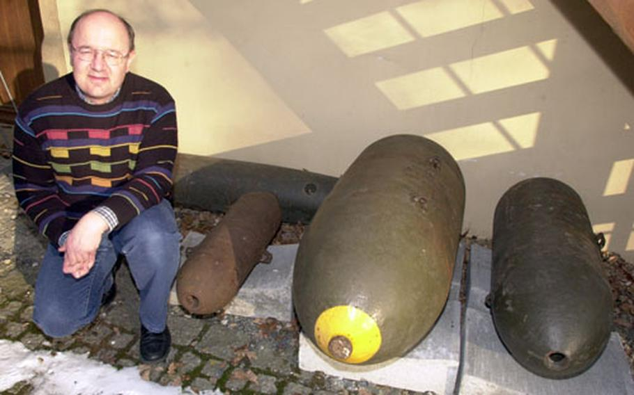 Grafenwöhr Military Museum curator Olaf Meiler with some of the bombs dropped on the town and post on April 5 and 8, 1945.