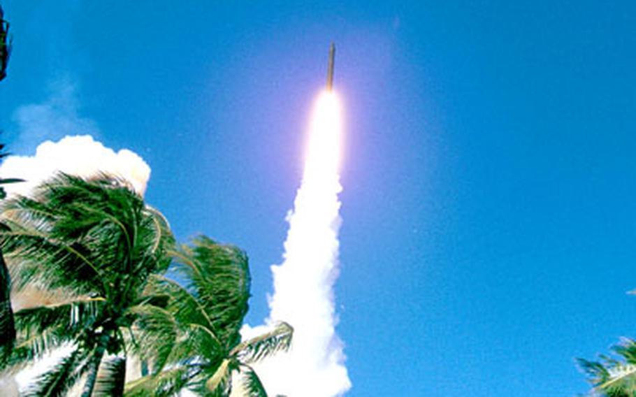 An interceptor missile rockets into the sky in a test launch.