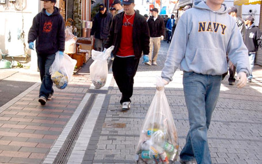 Volunteers from the USS Kitty Hawk have pledged to pick up trash twice monthly in the area around Yokosuka Naval Base.