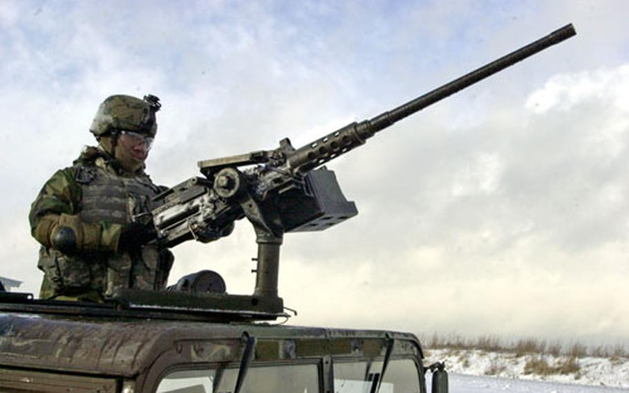 A 1st Battalion, 7th Field Artillery Regiment soldier mans an entry control point at Grafenwöhr Training Area, Germany, on Thursday.