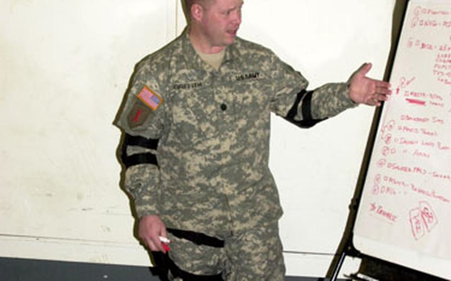 1st Battalion, 7th Field Artillery Regiment commander Lt. Col. Michael Griffith gives a platoon some pointers.
