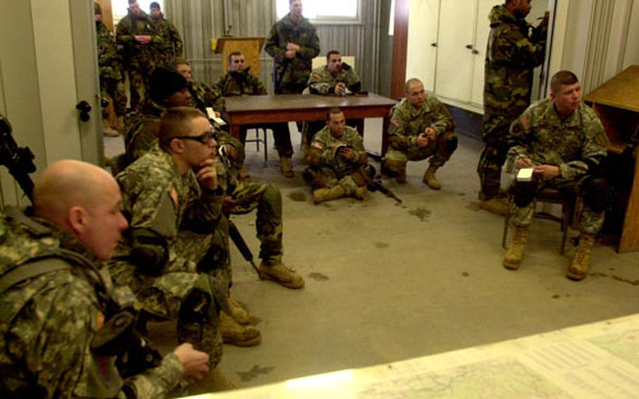 Members of the 1st Battalion, 7th Field Artillery Regiment review their performance after a maneuver exercise at Grafenwöhr Training Area on Thursday.