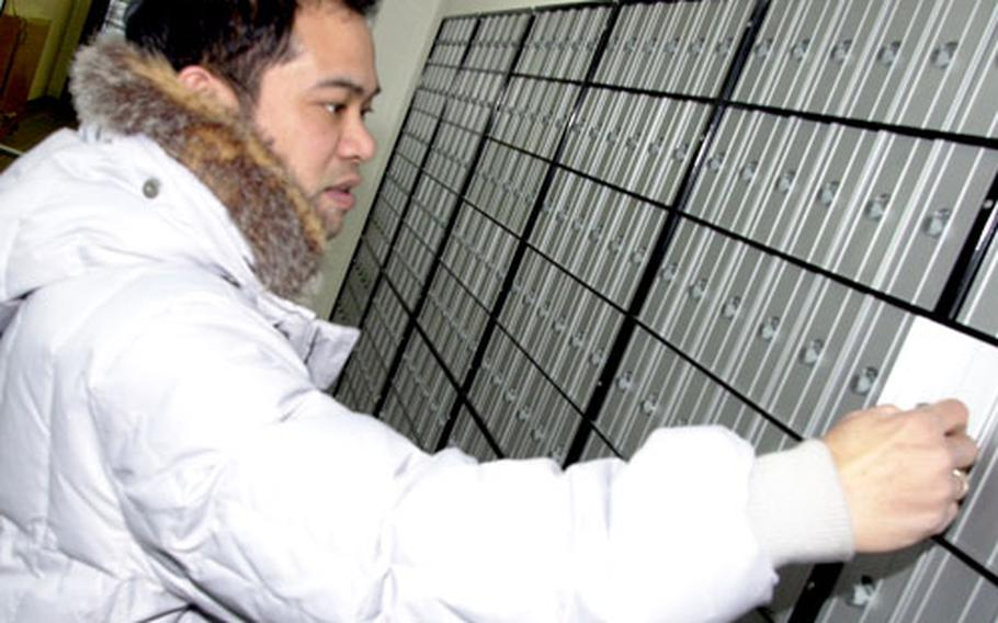 Postal officer Derick Ferrer checks out a new community mail room due to open at Grafenwöhr on Feb. 25.