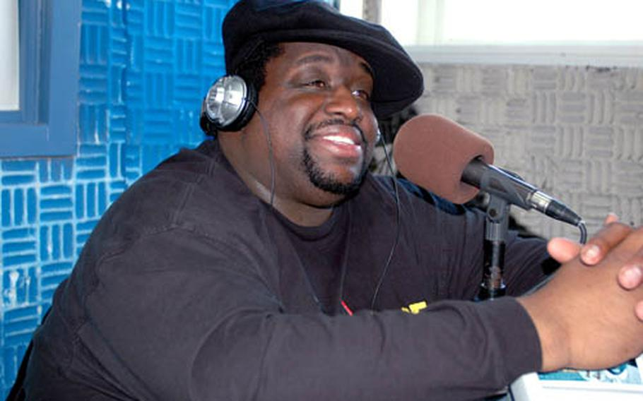 Comedian Bruce Bruce speaks on air at Sasebo Naval Base, Japan, where he had shows scheduled Monday and Tuesday following performances at Yokota Air Base in Tokyo last week.