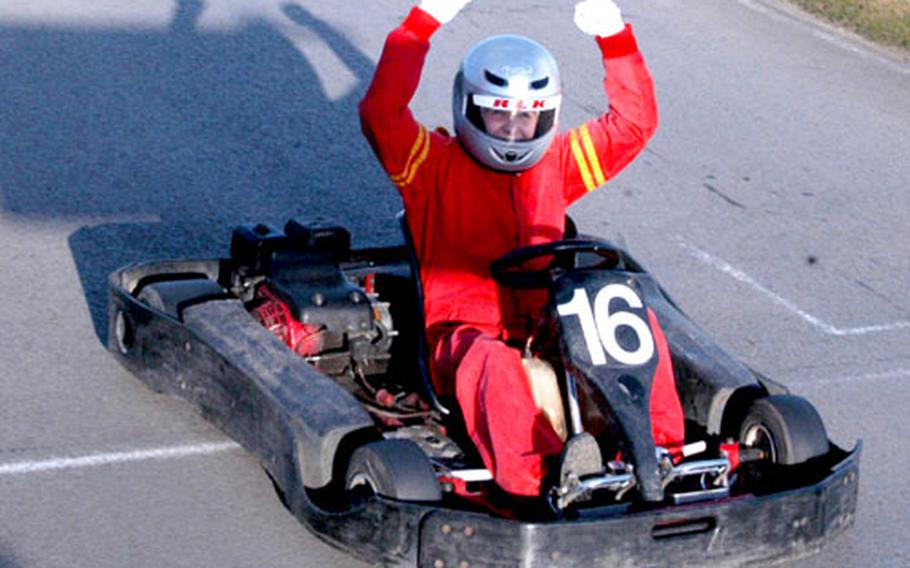 An RAF Mildenhall spouse celebrates crossing the finish line at Red Lodge Karting.