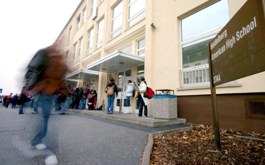 Students exit Heidelberg High School, Germany, after classes on Tuesday. The school was the site of a drug bust and controversial strip-search of some students on Friday.