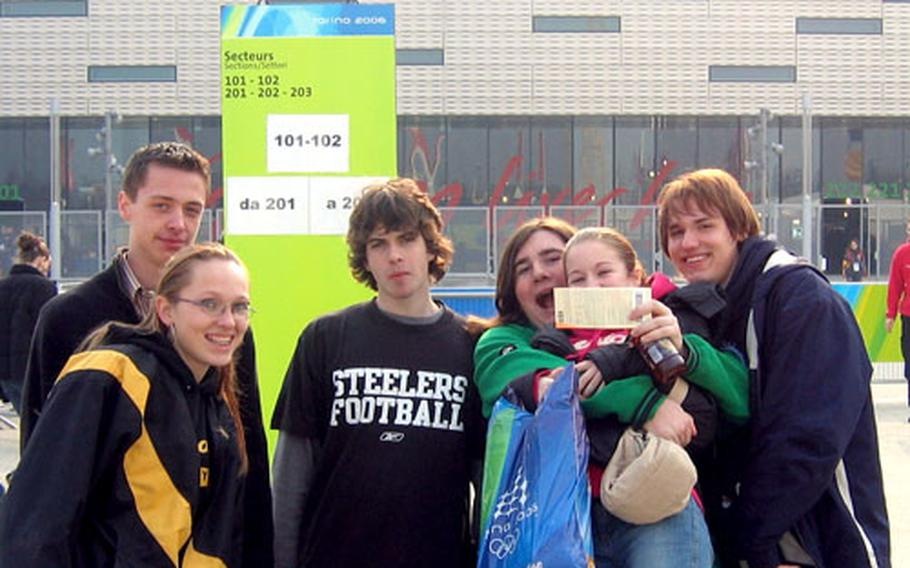 Students from Vicenza Middle High School pose for a photo outside the Torino Palasport Olimpico in Turin, Italy. Students, from left, are Derrik Arthur, Mary Kenney, Tim Sughrue, Steven Merlino, Jessica Boydston and Bruce Case.