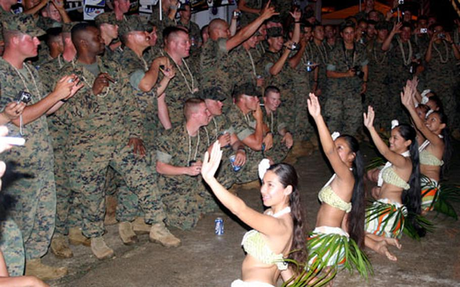Dancers with the Natibu Dance Academy Chamorro dance troupe entertain Marines with the 31st MEU during an evening barbecue at the residence of John Gerber, a Marine Corps veteran.