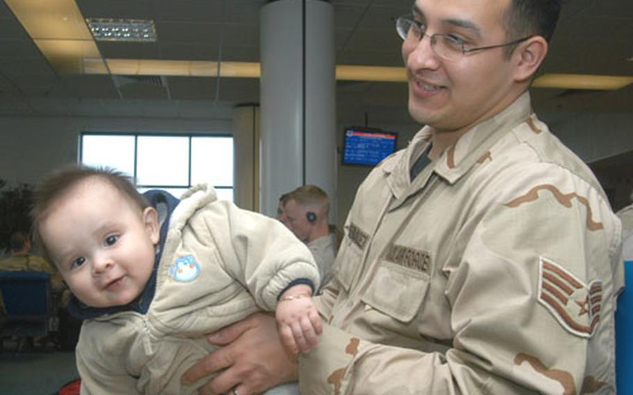 Staff Sgt. Joel Fernandez plays with his 8-month-old son, Jeremy, as he waits for a flight out of the RAF Mildenhall passenger terminal on Thursday. Fernandez, an aircraft communication and navigation maintainer from Mildenhall's 352nd Maintenance Squadron, left to a four-month deployment to Iraq.