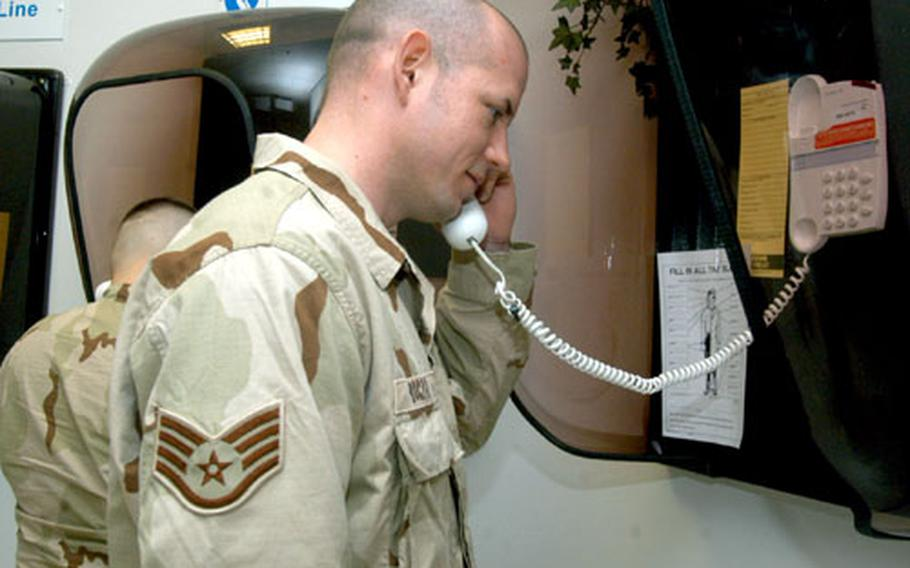 Staff Sgt. Stephan Boczar, a crew chief with the 352nd Maintenance Squadron, makes one last call at the RAF Mildenhall passenger terminal before deploying.