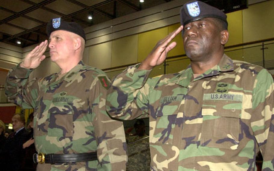 1st Infanty Division commander Maj. Gen. Kenneth W. Hunzeker, left, and Division Artillery commander Col. Walter L. Gilliam salute during a Divarty inactivation ceremony at Warner Barracks, Bamberg, Germany, on Wednesday.