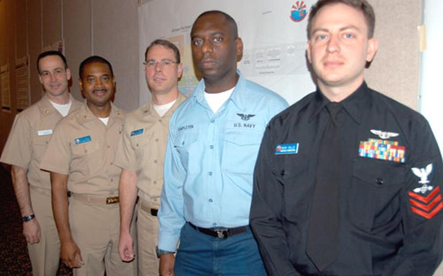 Lt. Cmdr. Art Harvey, far left, from Naval Air Systems Command in Patuxent River, Md., is the lead military facilitator on the Naval Air Facility Misawa team providing training on Enterprise AIRSpeed, a new program to improve naval aviation maintenance and supply practices. Other Misawa personnel helping with the implementation include, from left, Lt. Cmdr. Freddie Davis, Lt. Darren Wright, Petty Officer 1st Class Donald Templeton and Petty Officer 1st Class Nick Cillo.