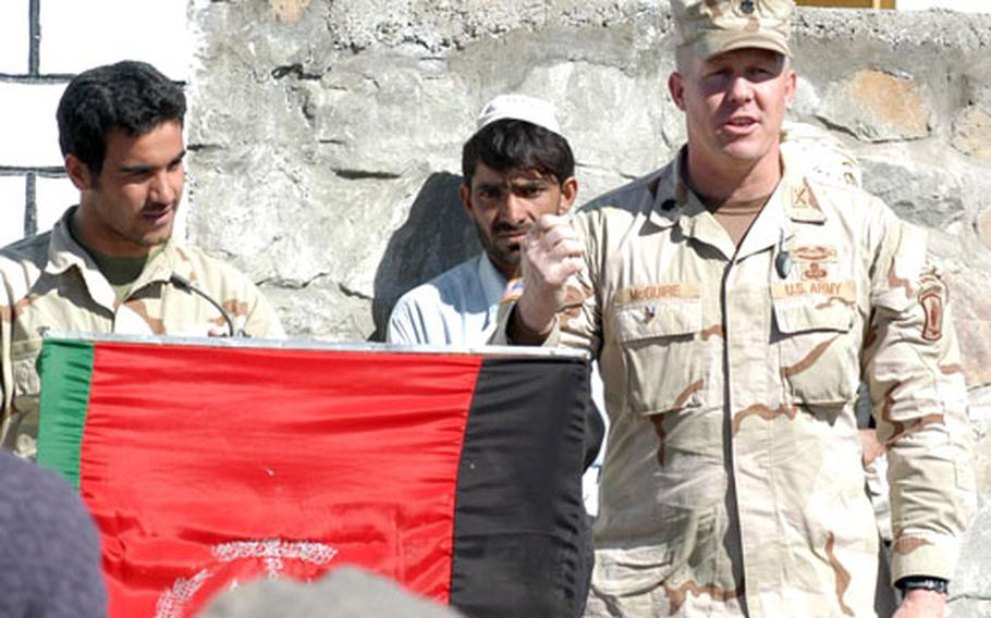 /Lt. Col. Tim McGuire, commander of the 1st Battalion, 508th Infantry Regiment, speaks at a ribbon-cutting ceremony Wednesday for the new school in Zeruk, Afghanistan. The Red Devils are set to leave the province of Paktika at the end of the week.