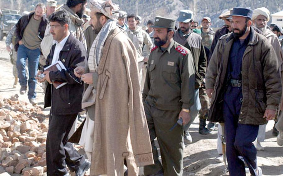 Gulab Mangal, the governor of Paktika province, arrives with entourage in tow for a ribbon-cutting ceremony for a new school in Zeruk, Afghanistan, on Wednesday.