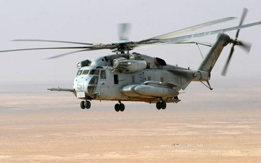 Two U.S. Marine Corps CH-53E helicopters, similar to the one shown, went down Friday carrying a dozen troops.
