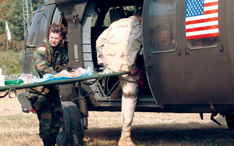 Lt. Col. Linda Lebedovych helps evacuate a baby in November 2005 to an Islamabad hospital after the baby spent the night attached to a ventilator in the 212th MASH ICU. The MASH donated its entire mobile hospital to Pakistan and will return home to Germany within the week.