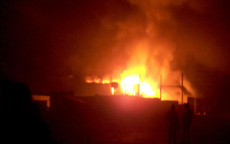 The main building at FOB Yusafiyah burns on Feb. 5.