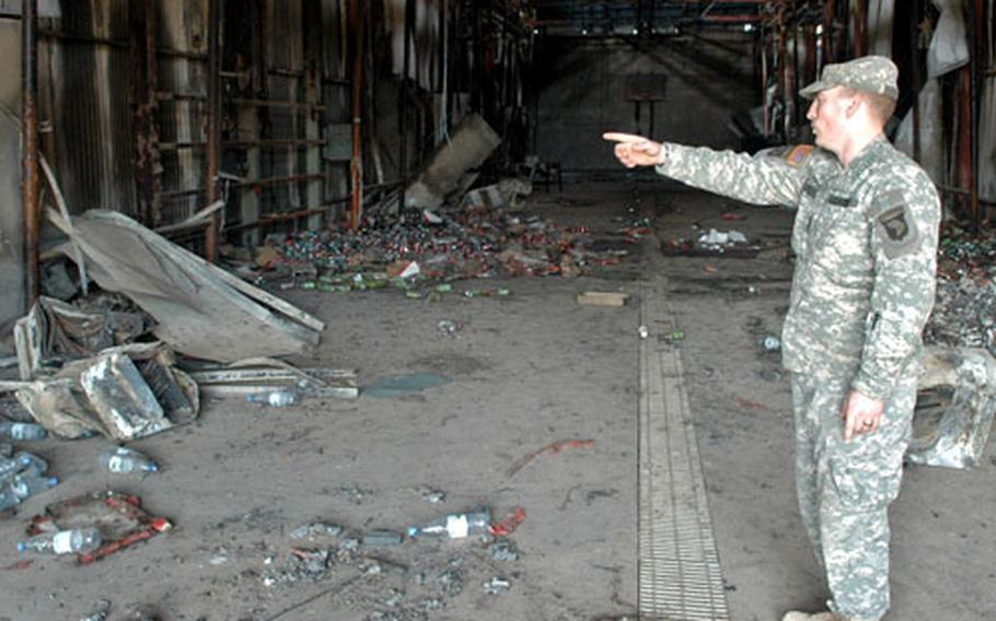 Sgt. Nathan Loper shows where his company kept its headquarters and barracks until an electrical fire on Feb. 5 destroyed the building.