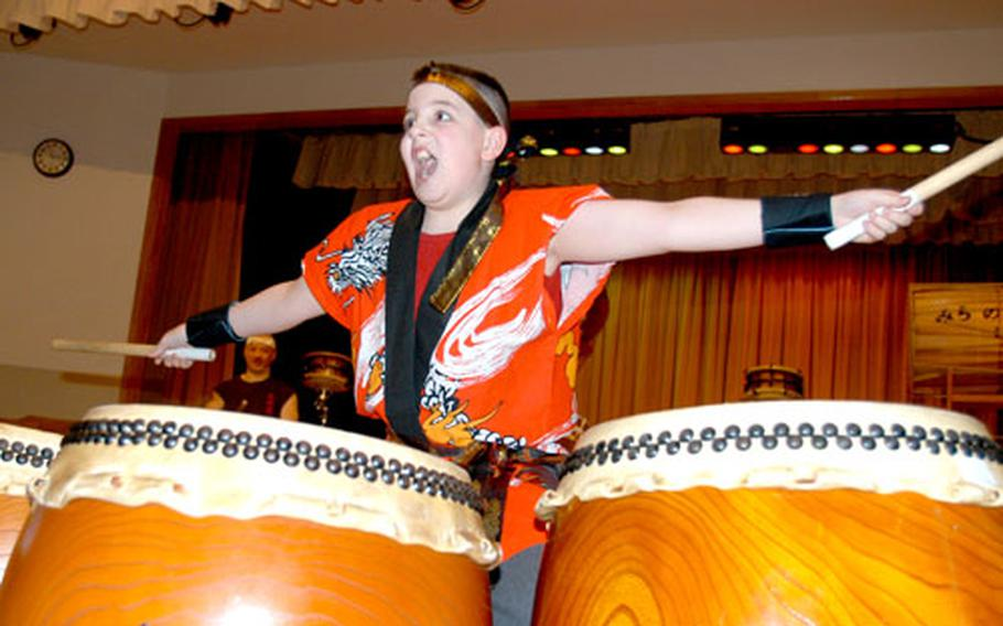 """Evan """"Bear"""" Weiss II ends a song on taiko drums with some flair."""