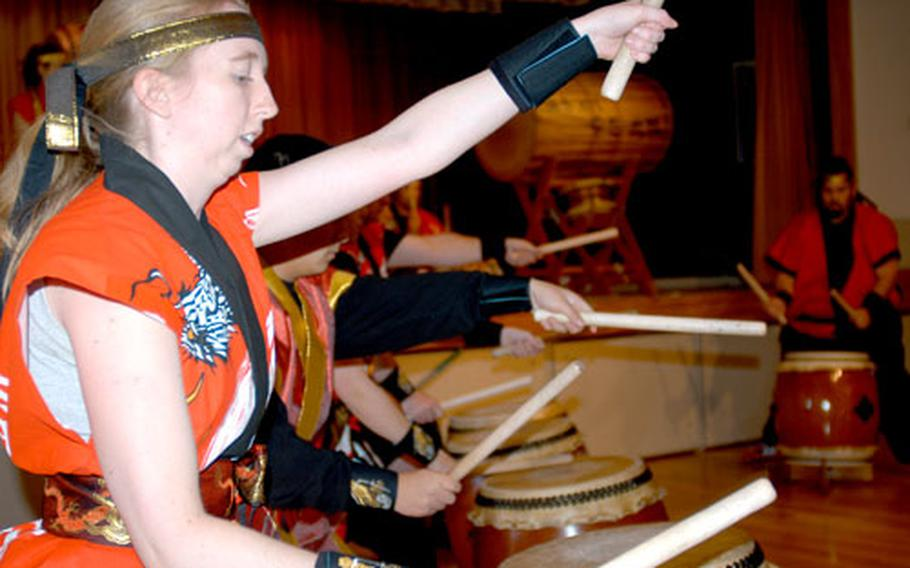 Emily Fiore plays the drums for the Dragon Eagle taiko drum group.