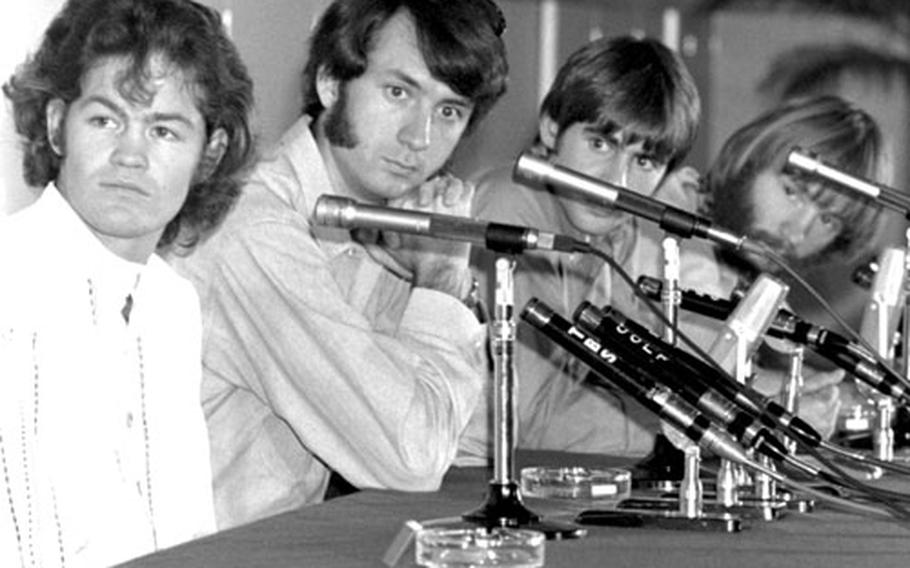 The Monkees listen to a question at a Tokyo press conference in 1968. Left to right, Mickey Dolenz, Mike Nesmith, Davy Jones, Peter Tork.