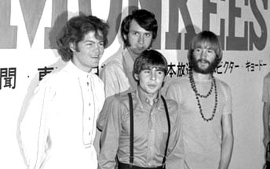 The Monkees pose for photographers.