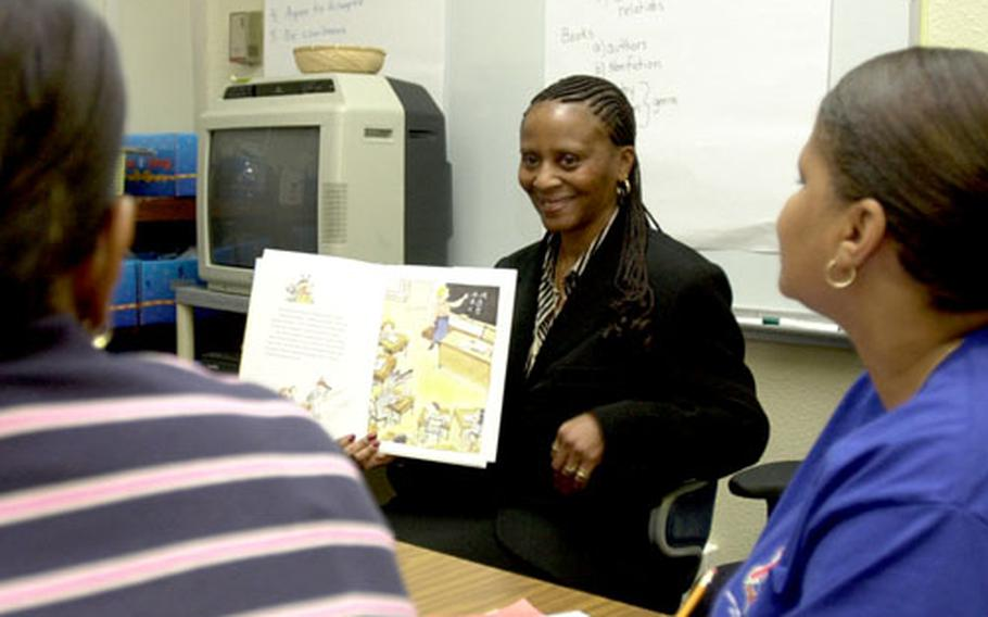 Zukeran Elementary School literacy teacher Jardell Peters reads a book to parents to demonstrate how they can help their children improve reading comprehension at home.