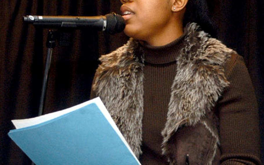 """Staff Sgt. Natasha Cottrell, a personnel specialist with the 48th Operations Support Squadron, delivers a love-inspired poem titled """"It Ticks"""" during a poetry showcase at RAF Alconbury last week."""