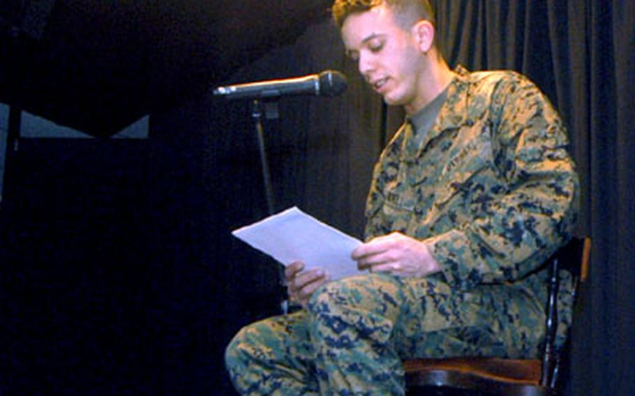 """Marine Sgt. Luke Revell, a member of the Joint Analysis Center, recites an original poem titled """"As the Wheel Spins."""""""
