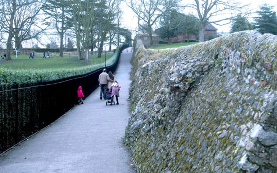 A family walks alongside a wall built by the Romans nearly 2,000 years ago.