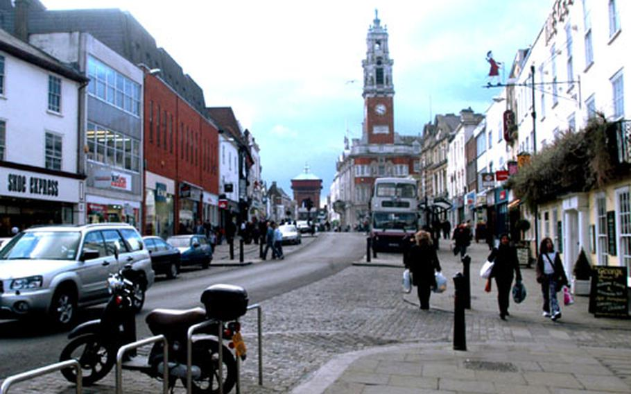 The town hall clock tower is seen in the distance on High Street in the City Centre.
