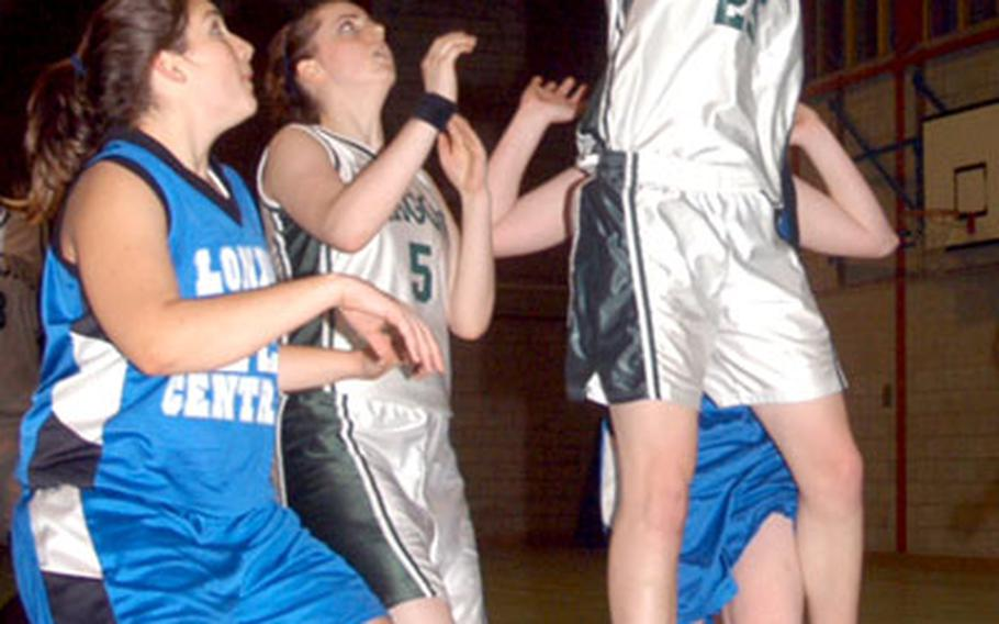 Alconbury sophomore Ashlee Lane goes up for two of her six points in the game.
