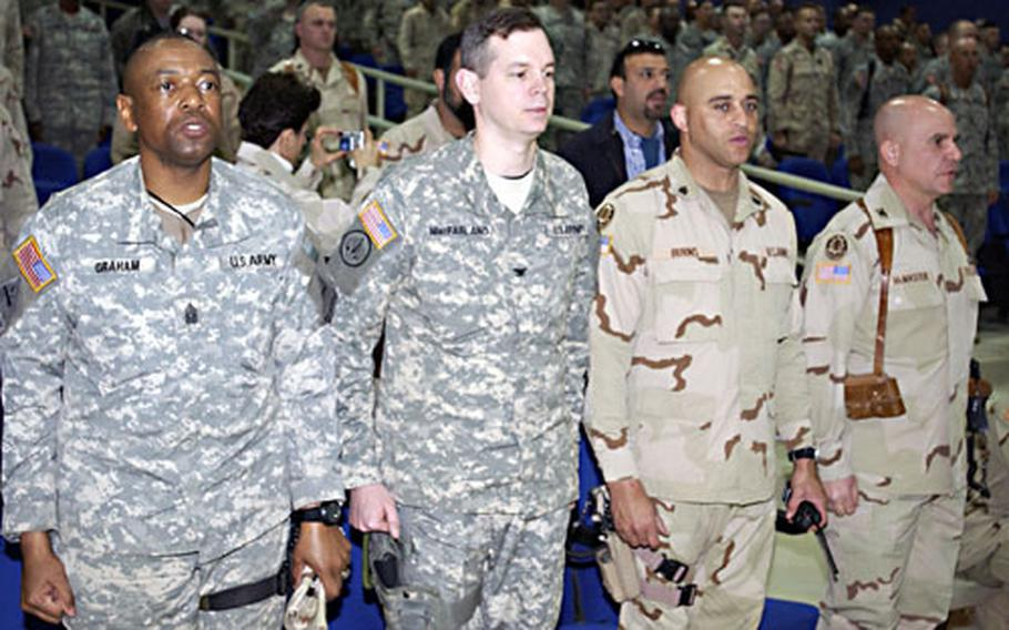 Command Sgt. Maj. Frank Graham and Col. Sean MacFarland, commander sergeant major and commander, respectively, of 1st Brigade Combat Team, 1st Armored Division stand alongside Command Sgt. Maj. William Burns and Col. H.R. McMaster, commander sergeant major and commander of 3rd Armored Cavalry Regiment.