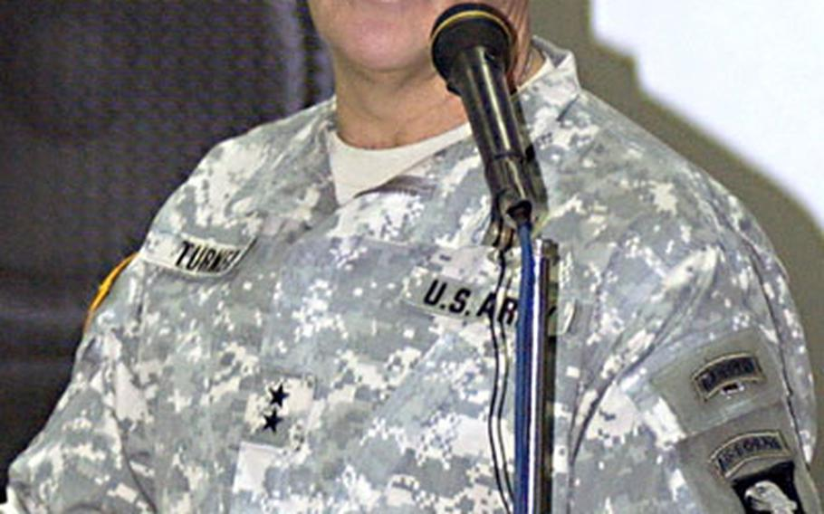 Major Gen. Thomas Turner, commander, 101st Airborne Division and Task Force Band of Brothers, speaks at Sunday's transfer of authority ceremony.