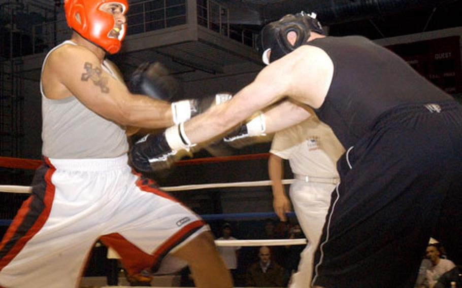 Staff Sgt. Geremy Ganaway, left, parrys a blow from Staff Sgt. Arthur Schuenke during a superheavyweight bout at the Army's 2006 Crown Jewel boxing Invitational at Camp Carrol in Waegwan, South Korea. Ganaway defeated Schuenke in the bout; both are from Camp Carroll.