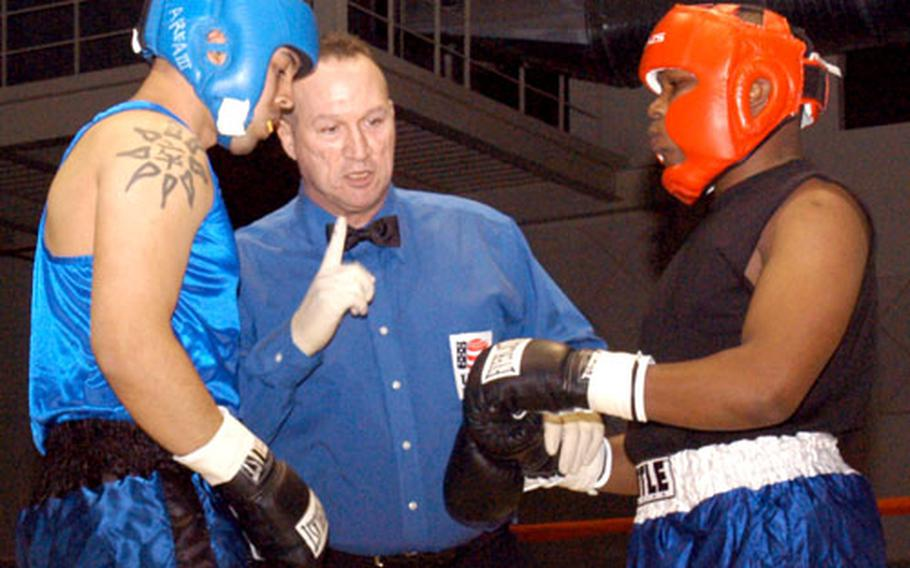 """Referee Sgt. 1st Class Charles Ryan goes over the rules just before light-heavyweight bout between Staff Sgt. Rene """"Lando"""" Aleman, left, of Camp Stanley, and Sgt. Michael Carroll of Camp Carroll. Aleman won the fight."""