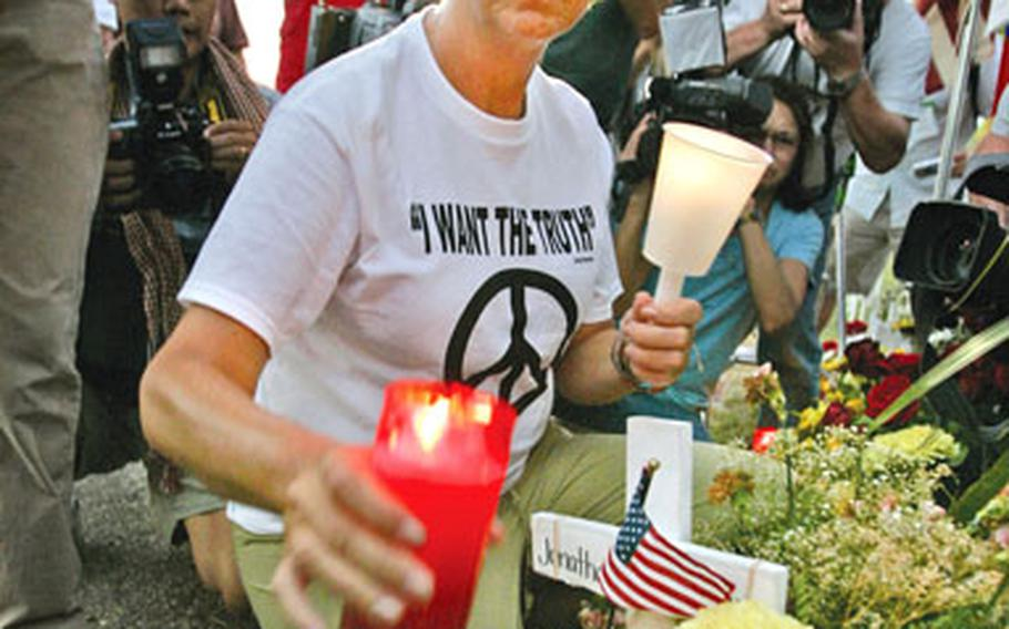 Cindy Sheehan, of Vacaville, Calif., leads a candlelight vigil near President Bush's ranch in Crawford, Texas, on Aug. 17, 2005. Sheehan is planning to visit U.S. military installations in Germany next month.