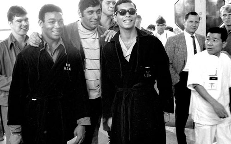 Joe Namath poses with a group of servicemembers at Camp Oji, Japan, in January, 1969.