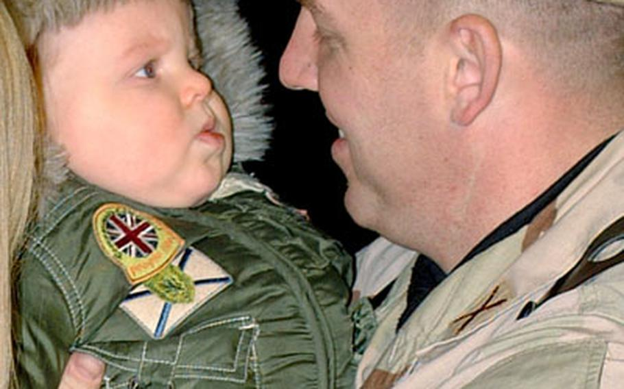 Nicholas Czarkowski isn't sure what to make of the man holding him — his father. Capt. Kevin Czarkowski is one of hundreds of Southern European Task Force and 173rd Airborne Brigade soldiers returning to nothern Italy after a yearlong deployment to Afghanistan.