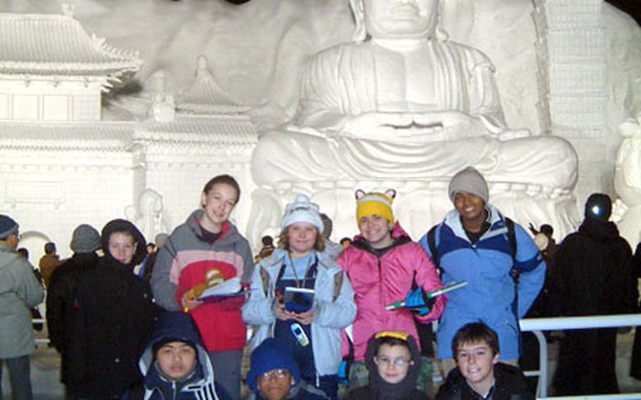 """Students from Cummings Elementary School at Misawa Air Base, Japan, stand in front of the """"Big Buddha"""" snow sculpture at the Sapporo Snow Festival earlier this month."""