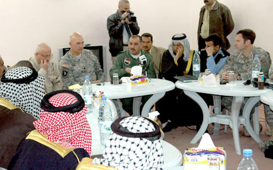 U.S. military leaders and local sheiks meet in Mahmudiyah, Iraq. The U.S. troops trying to create a local government and peaceful discourse say they suffered serious setbacks with the recent killings of prominent Sunni leaders.