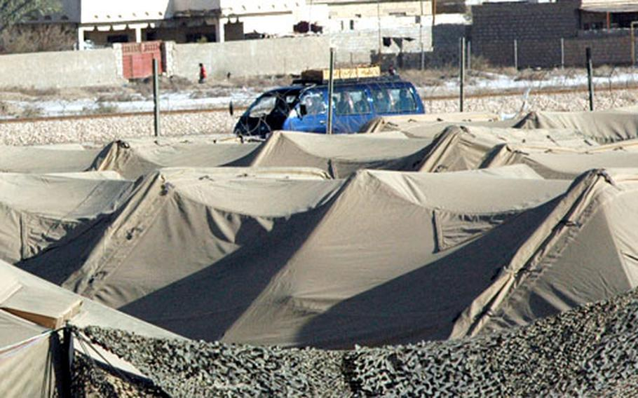 Dozens of cars bearing caskets drove south through Mahmudiyah on Friday. U.S. troops fear the caskets may be a covert attempt to smuggle weapons into the region to prepare for open sectarian warfare.