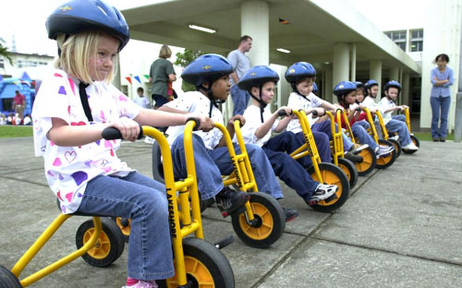 Kindergarten students at Bob Hope Primary School on Kadena Air Base line up and prepare to race 100 feet as they celebrated the 100th day of school Friday.