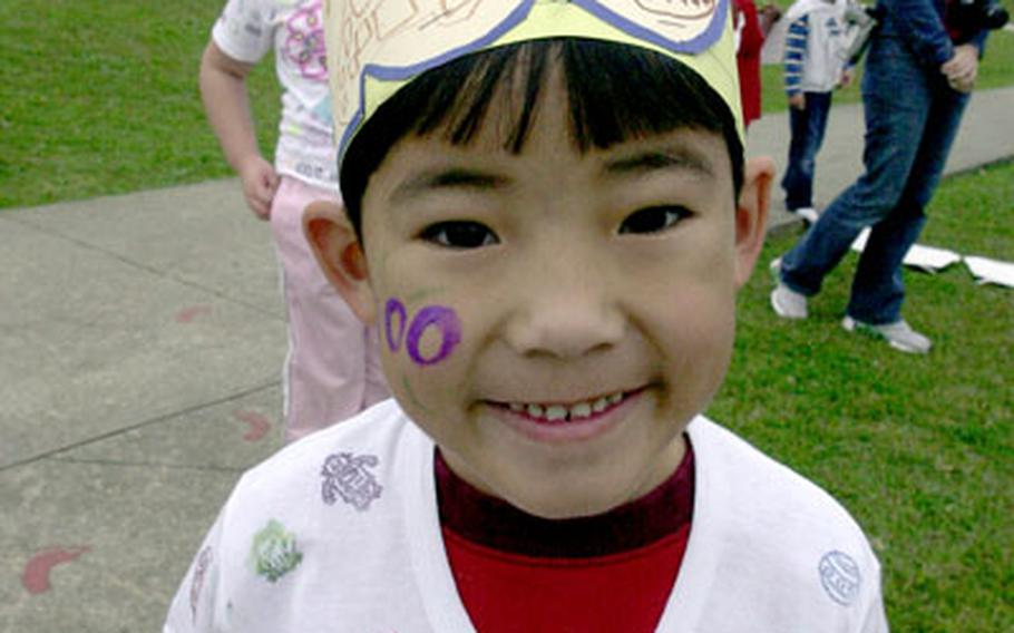 Bob Hope Primary School kindergarten student Riley Cullen shows off his 100th-day-of-school hat and shirt.