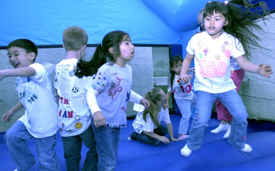 Students jump in a bouncer and counted to 100 by fives — a favorite activity of many of the children.