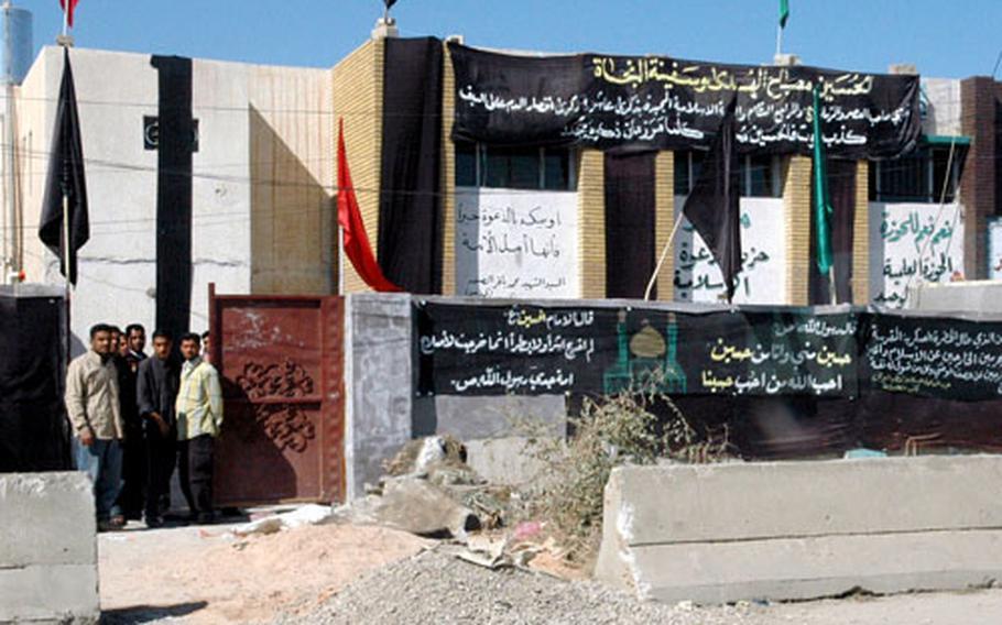 The local Mahmudiyah, Iraq, headquarters of the Mahdi militia, a Shiite-run organization, engaged in a firefight with a local Sunni tribe on Saturday night. The Iraqi army said three or four militia members were injured.