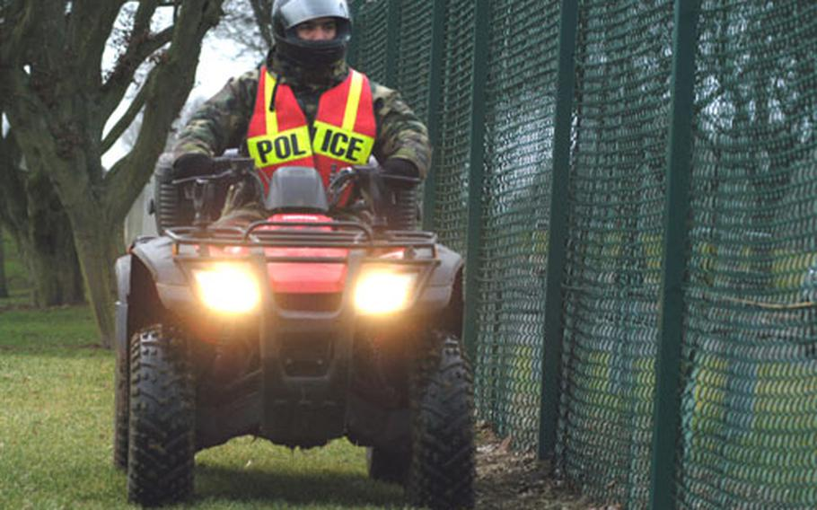 Airman 1st Class Anthony Harmon, an installation patrolman for the 422nd Security Forces Squadron, drives an all-terrain vehicle along the perimeter fence of RAF Croughton. Patrolmen use ATVs to check for suspicious activity in areas that patrol cars can't get to.