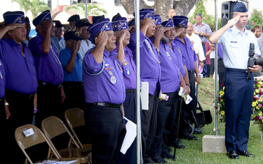 Members of the Military Order of the Purple Heart Chapter 1315 salute during the National Anthem.