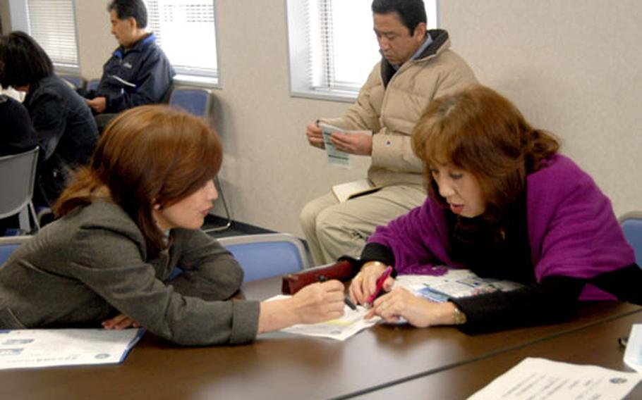 Yokosuka housing agents gathered at the city's Chamber of Commerce building on Tuesday to learn about Yokosuka Naval Base's new initiative to provide 500 off-base apartments for single sailors.