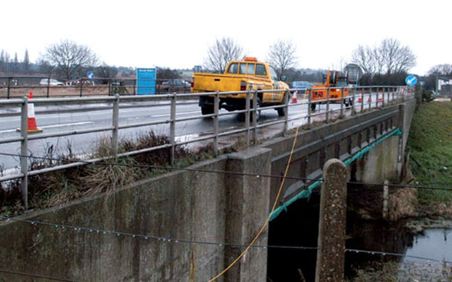 Motorists travel across the White Fen Bridge from Lakenheath toward RAF Feltwell. The bridge, which crosses the Cut-Off Channel, is being replaced.